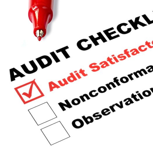 Paper and pen detailing an audit checklist
