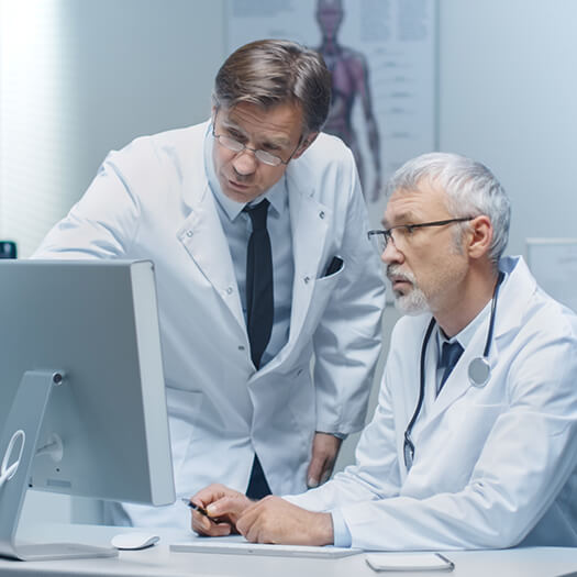 Clinical researchers at a computer