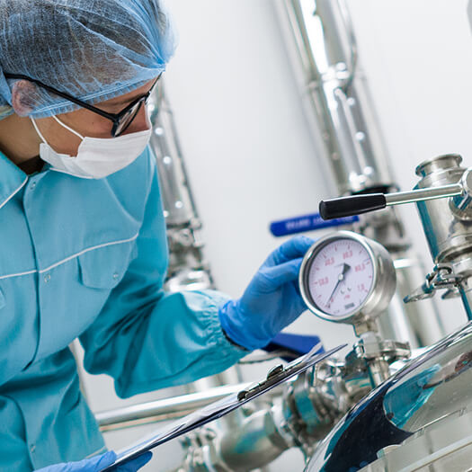 Clinical lab worker using lab equipment