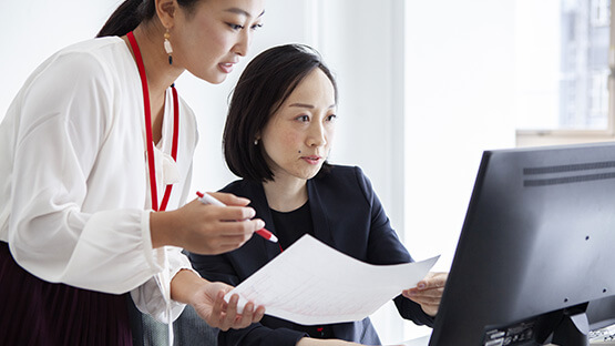 Office workers comparing documents