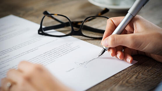Authorization on paper with glasses on desk