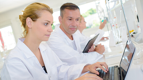Clinical workers using eTMF software