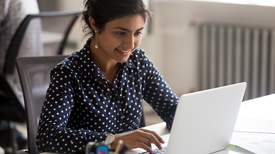 Worker using customer complaint management software