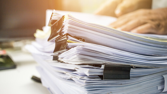 Batch records in stacks of paper
